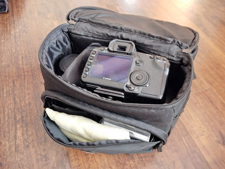 All my camera gear (except the tripod) fits nicely into a Tamrac 3350 Aero 50 Photo Bag F-Stop Small Shallow ICU case