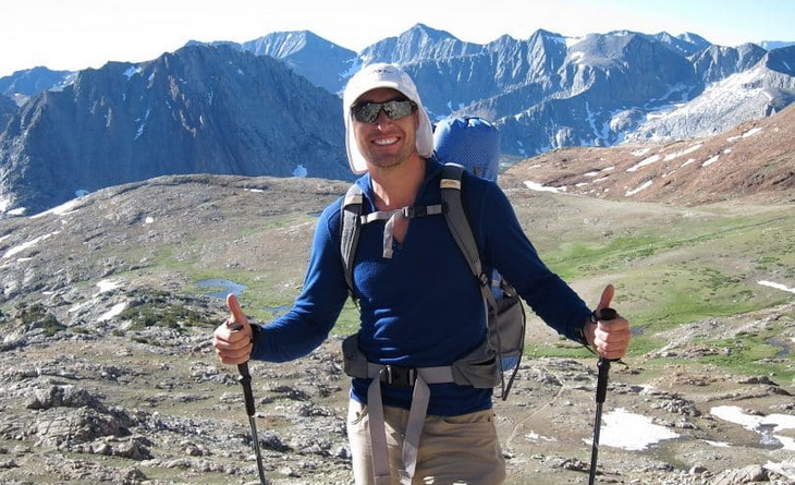 A man hiking at the Atop-Forester-Pass