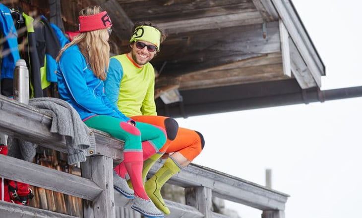 Two adults wearing base layers in the winter time