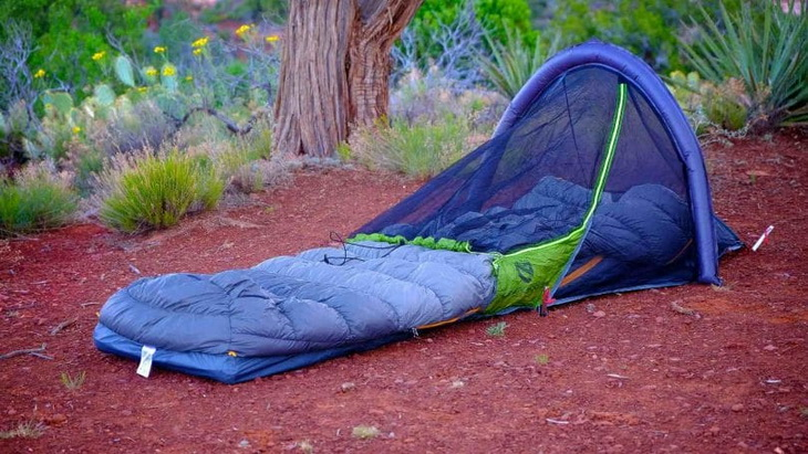 A bivy sack on a red ground