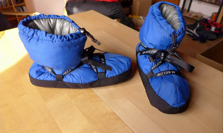 A pair of blue camping booties on the table