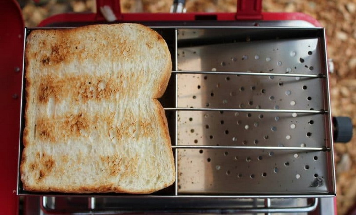 Frying a bslice of bread on a camp toaster