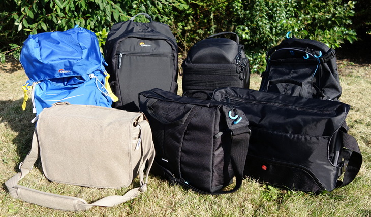 Different types of camera bags at one place outside on the grass