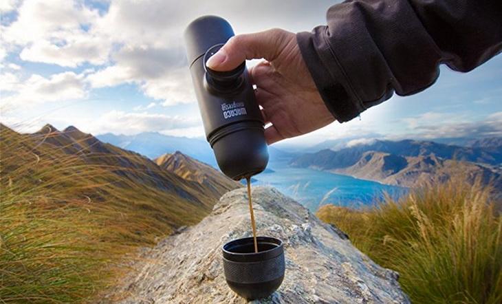 A person pouring coffe from the MiniPresso-GR-Espresso-Maker