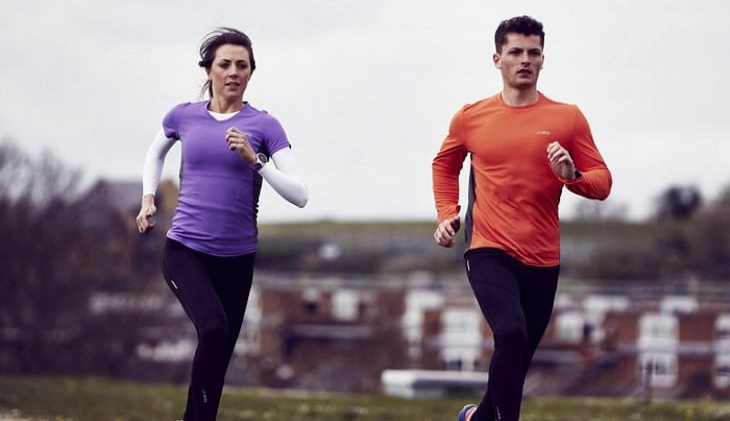 Two adults running wearing two base layers