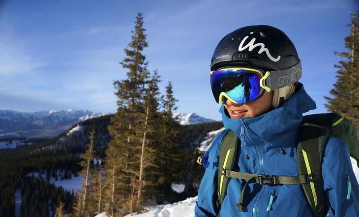 Woman wearing a hardshell jacket while skiing