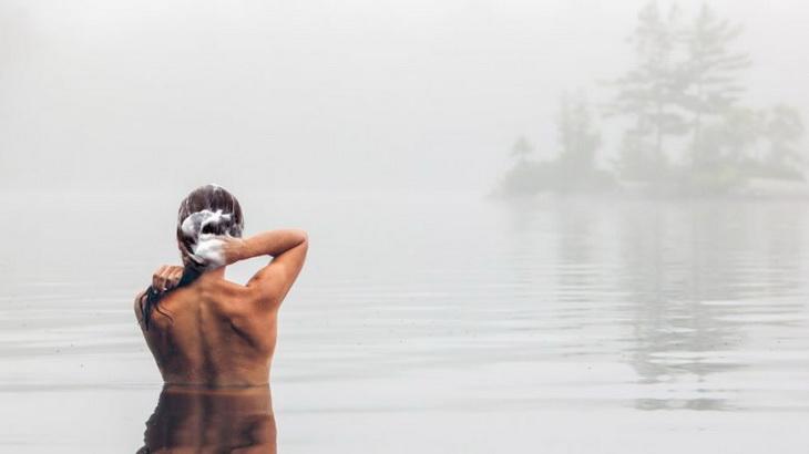 A woman bathing in a lake