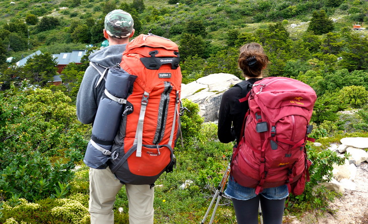 Two adults with backpacks