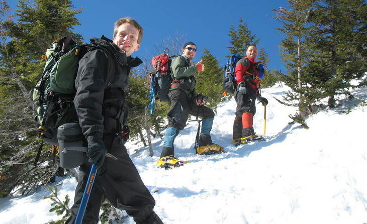 Hikers climbing the moutain in the winter time