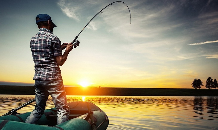A man fishing in the lake
