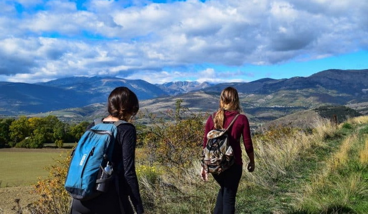 Two womens with backpacks enjoying the good weather