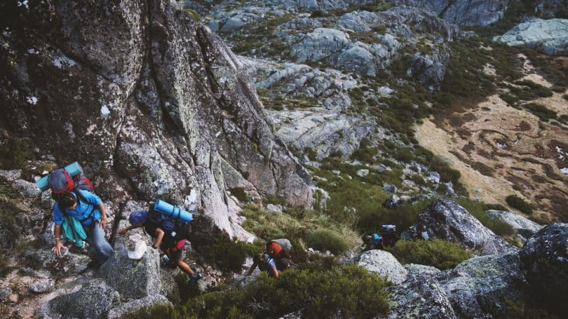 a group of people climbing the mountain