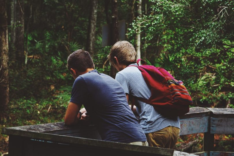 two adults backpacking in the nature