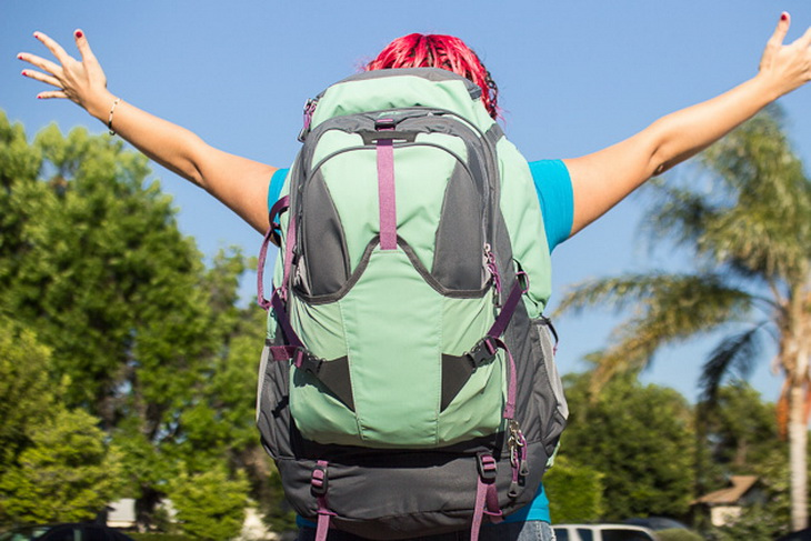 picture of a young woman carrying travel-backpacks