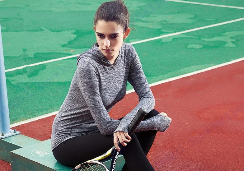 woman playing tennis in base layer clothing