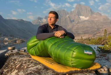 person sitting in a Western Mountaineering sleeping bag