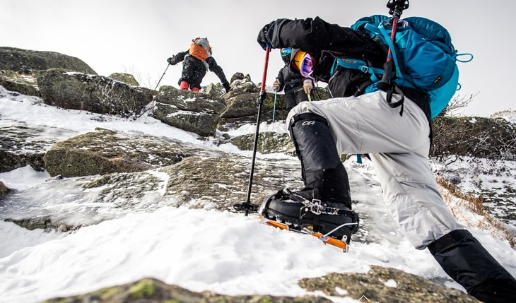 Backpackers climbing the mountains wearing Mountaineering Boots