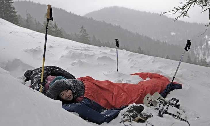 Person in a Bivouac Sacks during daytime