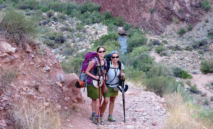 Two womens wearing hiking skirts are looking at the camera for a picture