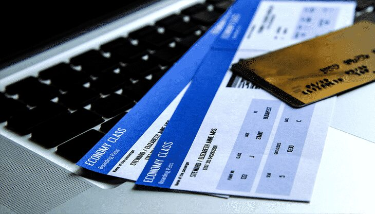 Economy class tickets on a laptop