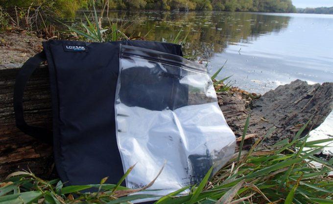 Black Loksak Opsak near a water