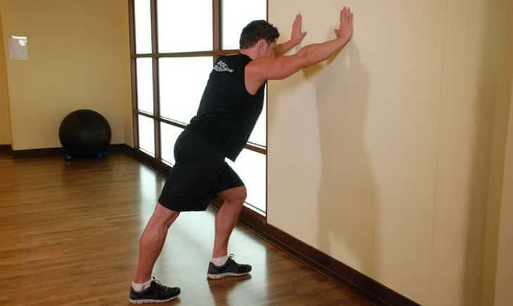 Man standing Calf stretches