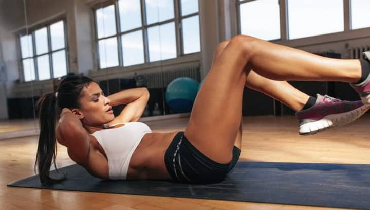 woman doing crunches exercise
