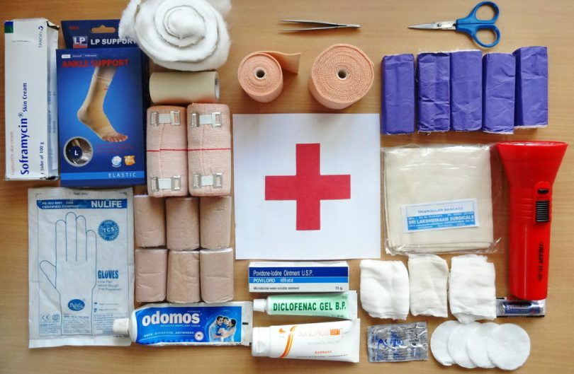 A first aid treatment kit on the table