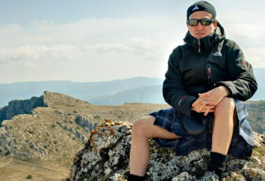 A man in kilt enjoying the nature around him