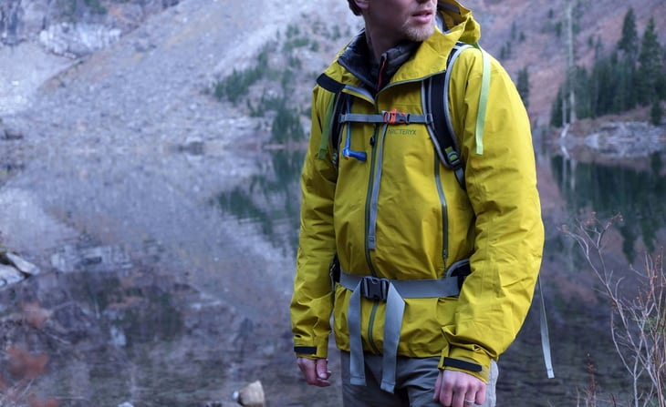 A man wearing versatile jackets for hiking and everyday use to ultralight emergency shells