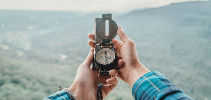 Image showing a person holding a compass for hiking