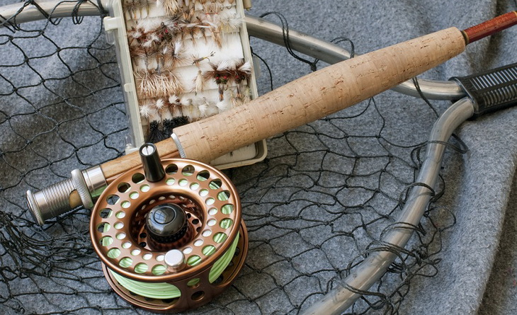 Image of a fly fishing rod on the ground
