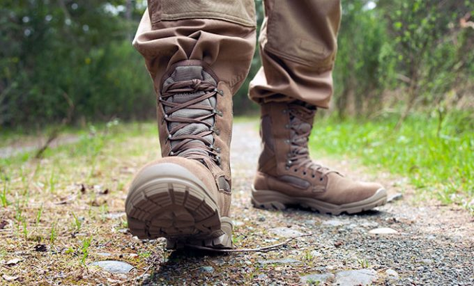 A man walking in a pair of jungle boots