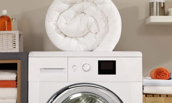 A pillow on top of a washing machine