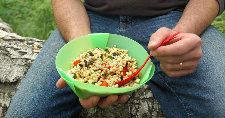 Picture of and Adult Eating Campfire Couscous Salad