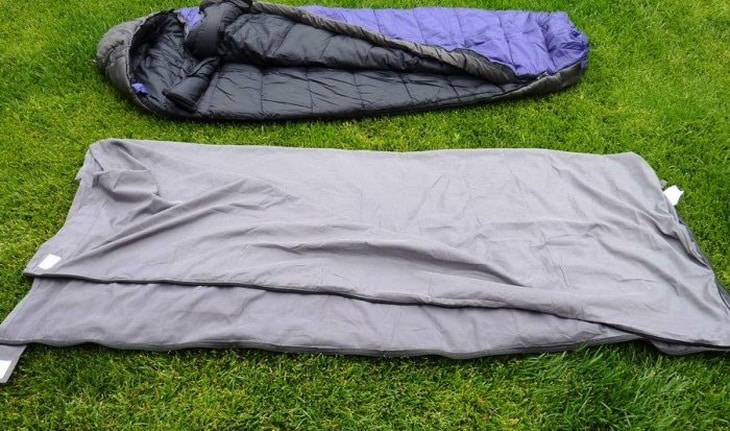 Two Sleeping Bag Liners on the grass