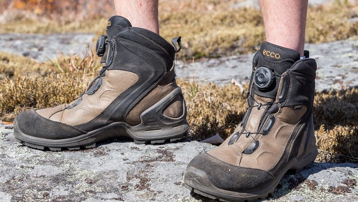 Man wearing a pair of ECCO-Mens-BIOM-Terrain-Mid-GTX-hiking-boot
