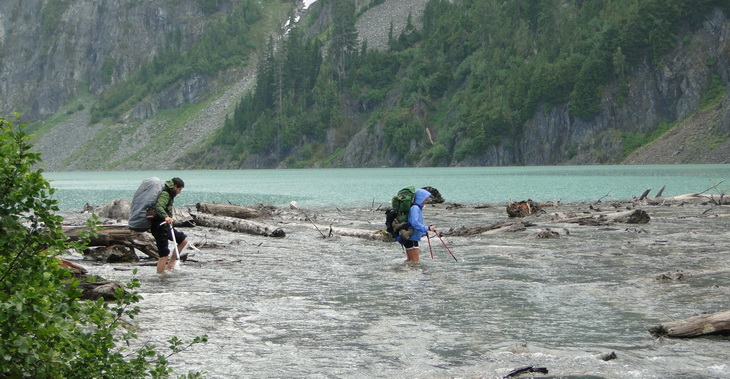 Fording the outlet of Blanca Lake, headwater North Fork Skykomish River.