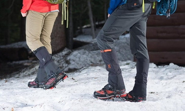 Two adults wearing gaiters on a winter time