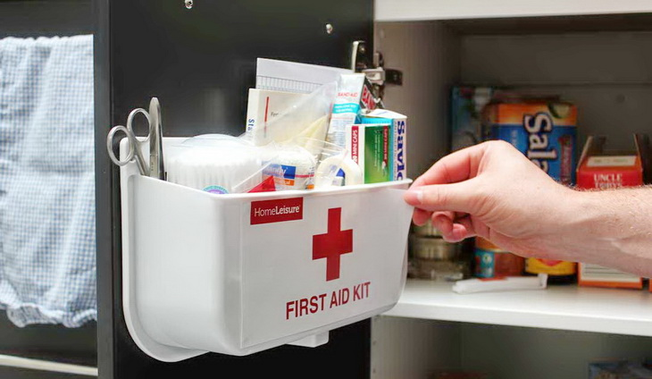 Man Working with a Home First Aid Kit