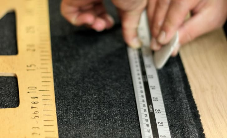 A person measuring some material