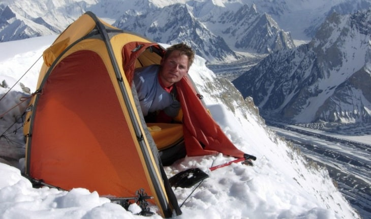 Man in a Polaris mountaineering tent
