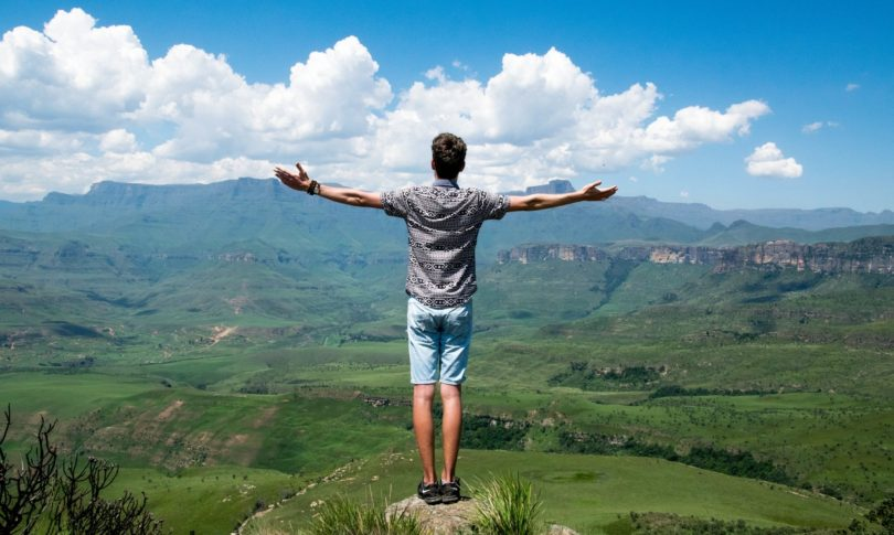 Man standing tall and looking at the landscape