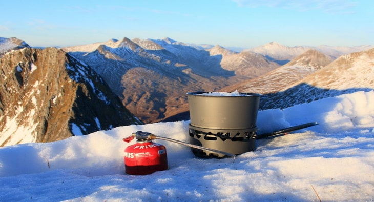 Melting snow for a brew with the Prime Tech stove and heat exchanger pot