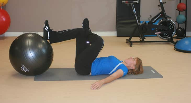 Woman doing Figure-4 stretch exercise