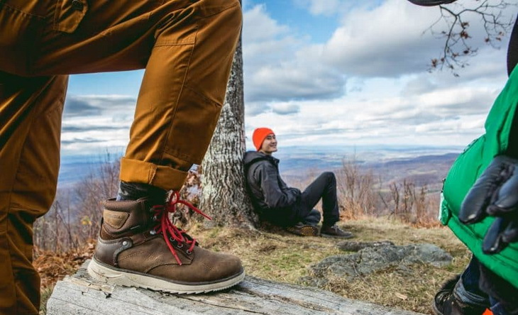 Image showing a man wearing a pair of stylish-hiking-boots and his friend next to him