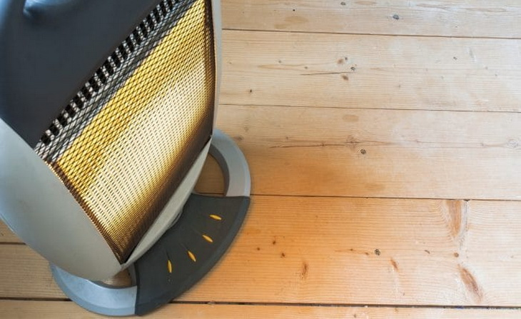 Image of a tent heater on a wooden floor