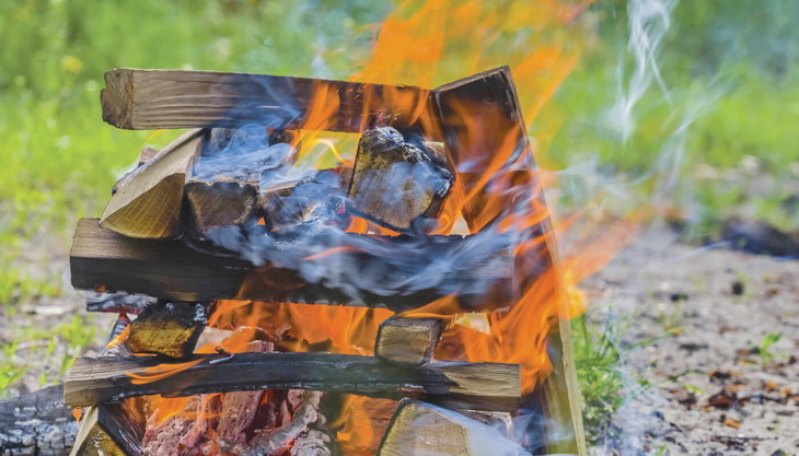 The crisscross layers of kindling are what makes the log cabin fire burn steadily and hot