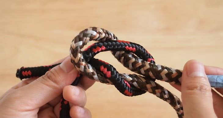 Man Tying a Square Knot