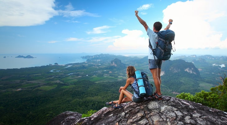 two adults on top of mountains